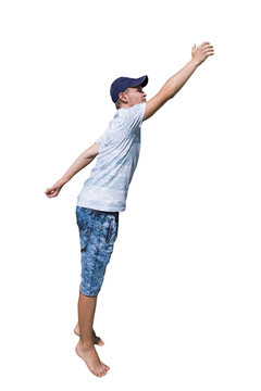Side view full length portrait of a casual young man wearing a hat hand stretched trying to reach to something isolated over white background.