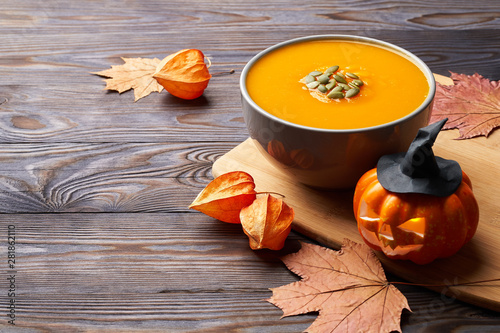 Pumpkin soup on the table. Vegan food. Halloween.