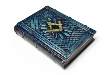Aged dark blue leather book cover with the Square and Compass symbol on the front cover. Captured while lay down to the table isolated.