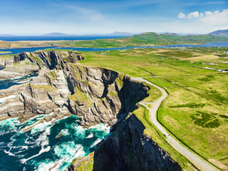 Amazing wave lashed Kerry Cliffs, the most spectacular cliffs in County Kerry, Ireland. Tourist attractions on famous Ring of Kerry route. Wall mural