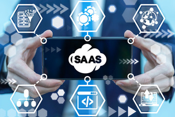 SAAS Software As A Service Cloud Data Transformation Mobile Technology. Man hold smartphone with saas cloud icon on screen.