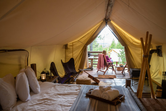 woman glamping in forest