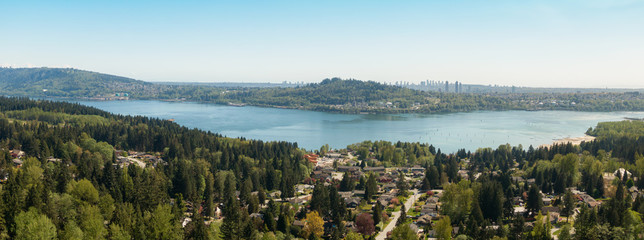 Aerial panoramic view of residential neighborhood in North Vancouver during a sunny day. Located in British Columbia, Canada.