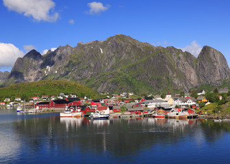 Garden Poster Scandinavia Traditional red colorful Norwegian fishing houses in Reine with mountains on the background, Lofoten Islands in northern Norway