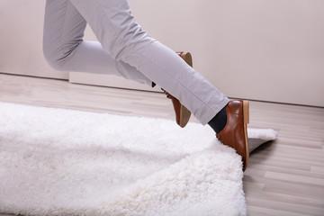 Fototapeta Man Stumble In A Carpet Near Ladder obraz