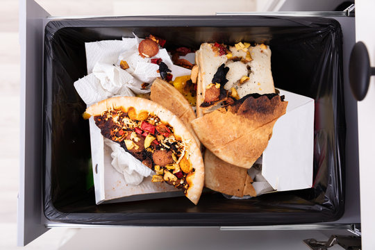 Dustbin Covered With Leftover Food