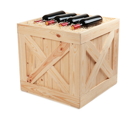 Wooden crate with bottles of wine isolated on white