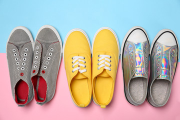 Wall Mural - Modern trendy sneakers on color background, top view