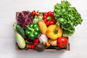 Keuken foto achterwand Keuken Crate with different fresh vegetables on light background, top view