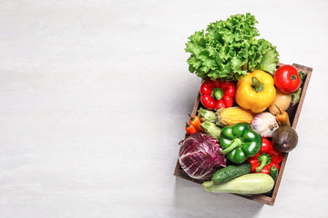Foto op Plexiglas Keuken Crate with different fresh vegetables on light background, top view. Space for text