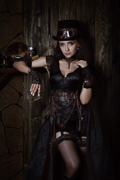 Sexy young woman in the style of a steampunk