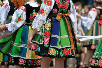 Polish women in traditional folk dressen walk in Corpus Christi procession in Lowicz Wall mural