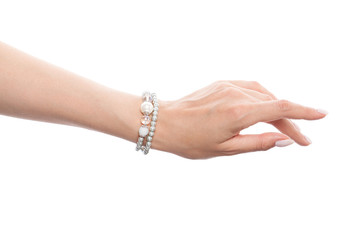 Hand wearing silver jewelry bracelet isolated on white background