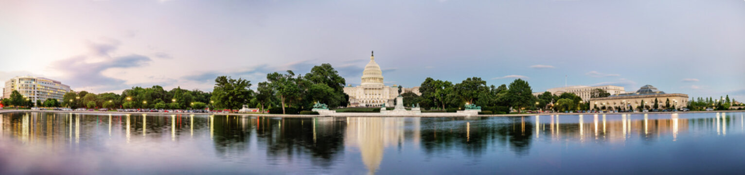 Panorama view of the United States Capitol building reflected on the reflection pool when sunset at nation mall, Washington DC, USA.