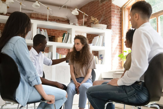Diverse people gather together at group therapy discuss personal problems