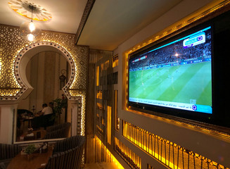 A TV broadcast of Bundesliga highlights, pirated by beoutQ, is seen at a local cafe in Khobar