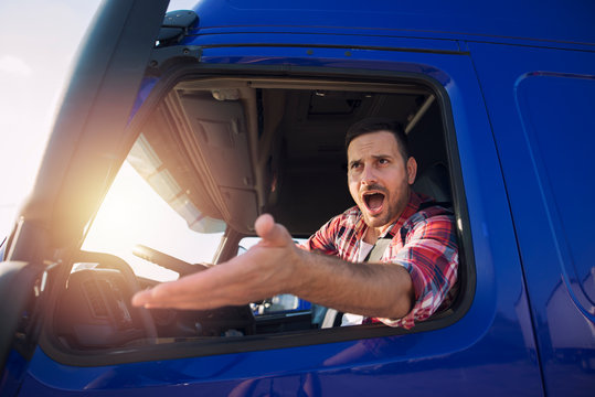 Angry and nervous truck driver yelling at someone in traffic. Difficulties on the road.
