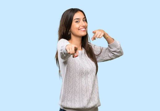 Young hispanic brunette woman points finger at you while smiling over isolated background