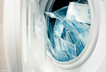 Brazilian money, hundreds of reais in the washing machine.  The concept of money laundering, corruption