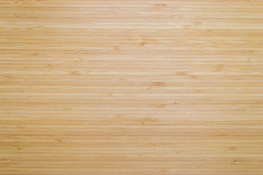 Bamboo wood texture background in natural light yellow brown color .