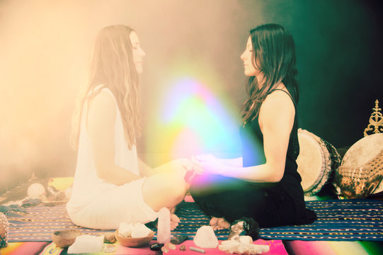 Shamanic Healers in rainbow aura energy field.