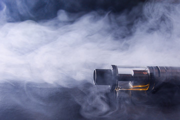 Abstract image of an electronic cigarette in smoke. copy space. The concept of the dangers of smoking, an alternative to cigarettes, bad habits.