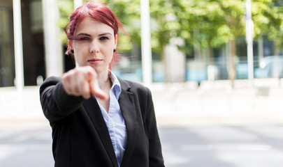Young businesswoman pointing the finger to the camera, recruitment concept