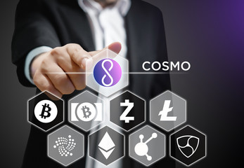 Concept of a Business man pointing at COSMO coin, a Cryptocurrency blockchain platform , Digital money