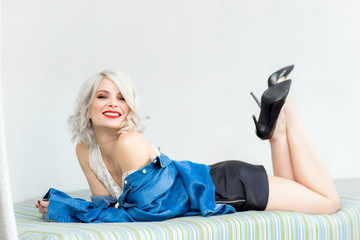 Beautiful, sexy, happy and fashionable blonde model girl look like Merilyne Monroe with perfect...