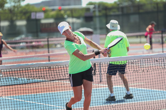 A senior woman competes in a pickleball tournament
