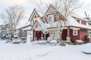A typical american house in winter. Snow covered. Wall mural