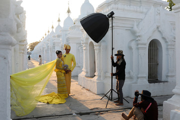 A couple poses for a wedding photo shoot at Kuthodaw Pagoda in Mandalay