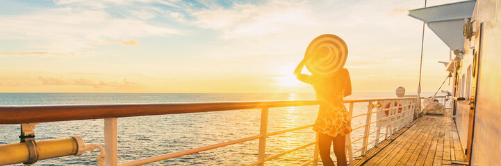 Cruise ship luxury vacation travel elegant woman watching sunset over Caribbean sea on deck boat summer tourist destination panoramic banner.