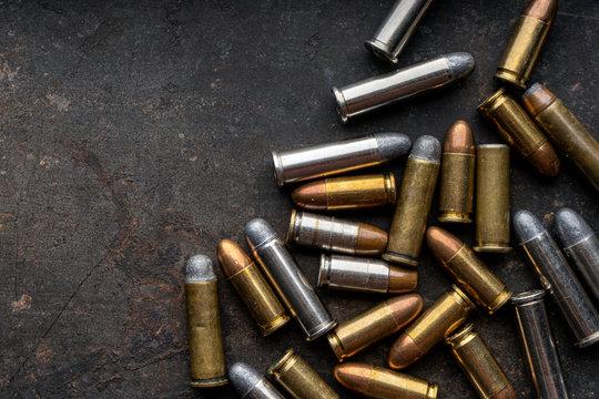 Hand guns , ammo ,Guns with ammunition on Dark background.