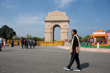 Thai women travel and posing take photo india Gate originally called the All India War Memorial at city of Delhi with indian people in New Delhi, India