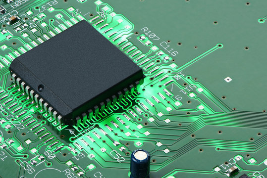 Backlit green printed circuit board with the processor
