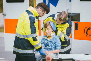 Boy is injured after accident, medics taking care of him