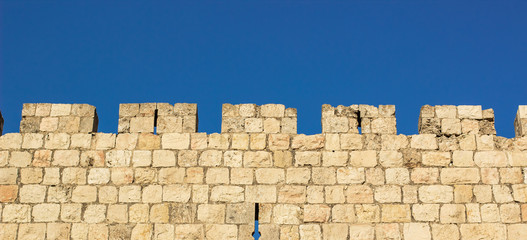 medieval castle stone wall protection construction building simple wallpaper pattern picture with blue sky background and empty space for copy or text