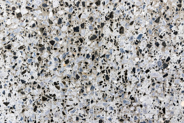 White marble terrazzo flooring pattern. Texture of mosaic floor with natural stones, granite, marble, quartz, limestone, concrete. Polished rock surface. Natural background
