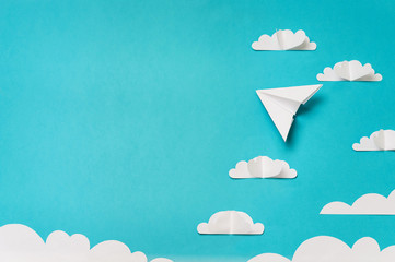 Paper cut clouds and origami planes. Creative concept for banner/landing/background designs.