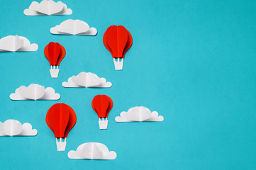 Hot air balloons in the sky paper cut and origami objects. Creative concept for banner/landing/background designs.