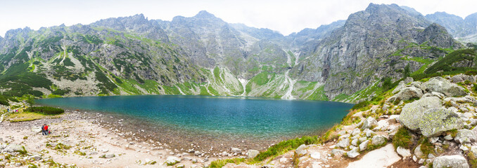 Picturesque panoramic view of Czarny Staw pod Rysami lake (Black Lake below Mount Rysy) in Tatra Mountains, Poland. 1583m above sea level. Mount Rysy (2499m), the highest point of Poland on background