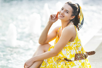 Closeup portrait of young attractive woman in yellow dress. Summertime leisure. Beautiful stylish...