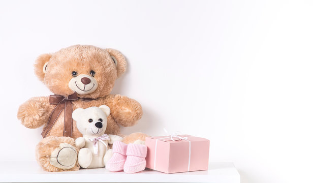 Newborn Expectation Party Baby shower. Children's room girls. Teddy bear and baby booties
