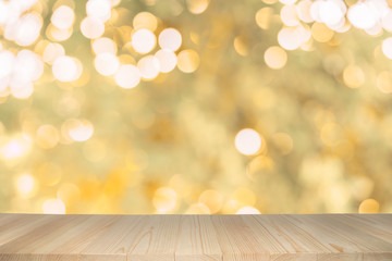 Empty wooden table on abstract background with colorful bokeh.