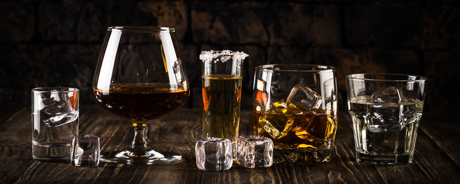 Strong alcohol drinks - whiskey, cognac, vodka, rum, tequila.