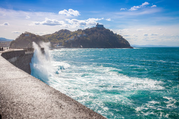 Beautiful seascape in northern Spain. The rocky coast on a sunny day. Beautiful nature, landscape with a stormy sea. The embankment in San Sebastian, Basque Country, Spain, Europe