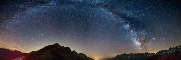 Foto op Canvas Nachtblauw The Milky Way arch starry sky on the Alps, Massif des Ecrins, Briancon Serre Chevalier ski resort, France. Panoramic view high mountain range and glaciers, astro photography, stargazing