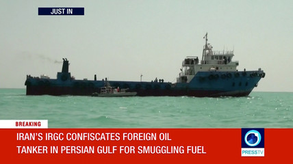 A screen grab from video footage from Iran's state-run English language Press TV showing, according to the source, a foreign oil tanker smuggling fuel in the Gulf