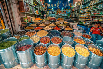 10/05/2019 Kerman,.Kerman Province.Iran, a huge variety of spices and herbs on a counter on a traditional Iranian eastern bazaar